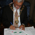 The Lord Mayor busy signing the Good Food Charter