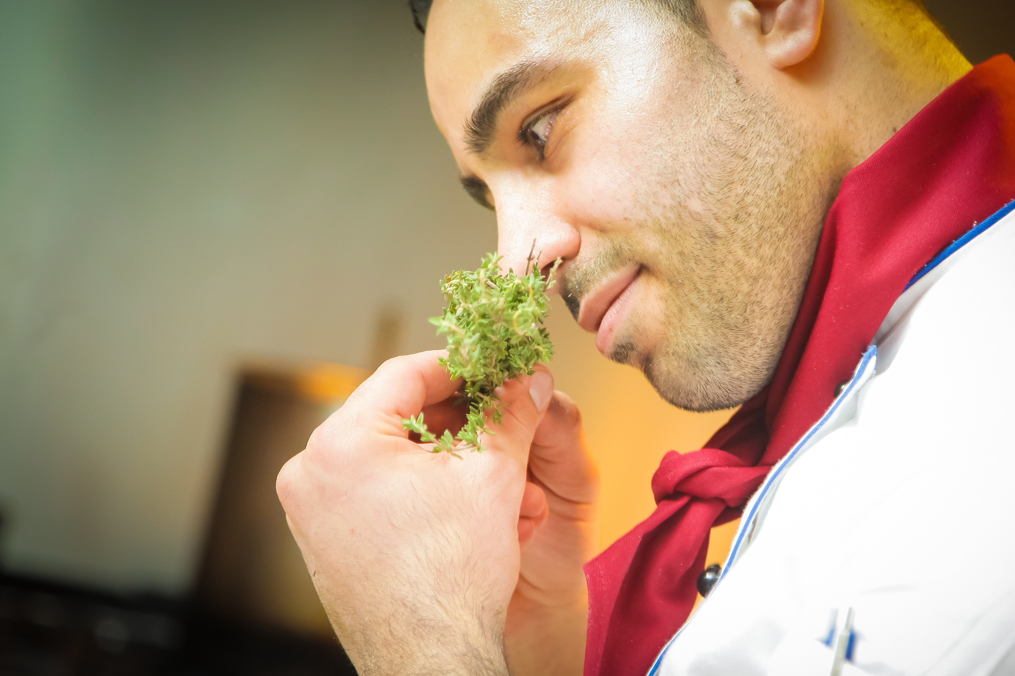 Chef sniffing herbs