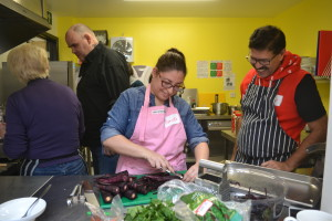 People cutting vegetables during cooking class