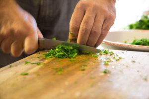 hand chopping greens